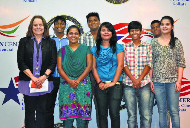 Raring to go: The seven students from West Bengal and adjoining States with JJ Joria, Director of American Center, Kolkata on Monday. — photo: special arrangement / The Hindu